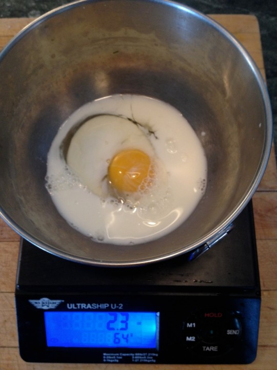 Weighing out the eggs and milk.